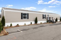 The VICTORY PLUS Exterior. This Manufactured Mobile Home features 3 bedrooms and 2 baths.