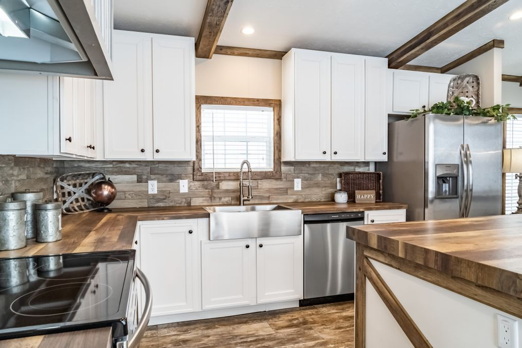 The THE BOBBY JO Kitchen. This Manufactured Mobile Home features 3 bedrooms and 2 baths.