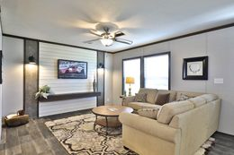 The BREEZE FARMHOUSE Living Room. This Manufactured Mobile Home features 3 bedrooms and 2 baths.
