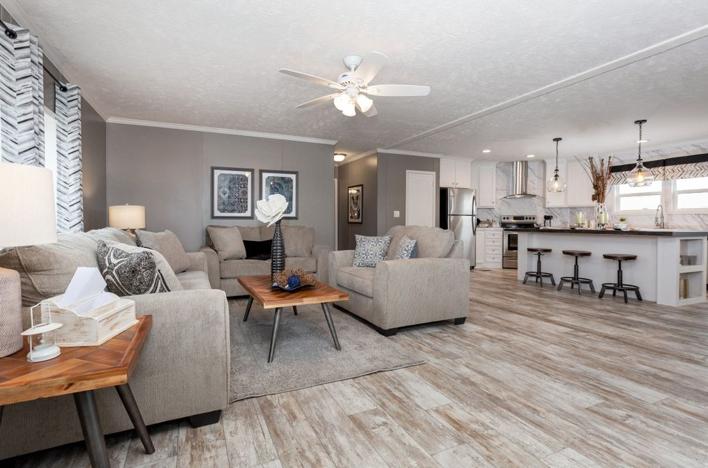 The THE CASCADE Living Room. This Manufactured Mobile Home features 4 bedrooms and 2 baths.