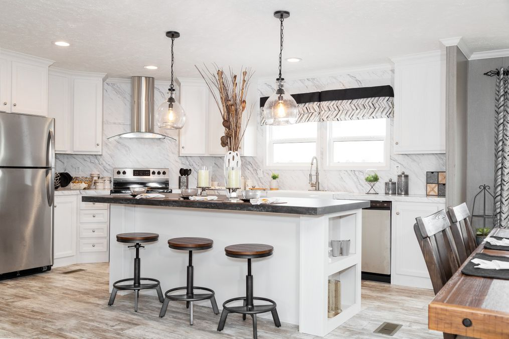The THE CASCADE Kitchen. This Manufactured Mobile Home features 4 bedrooms and 2 baths.