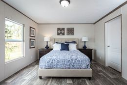 The THE BREEZE 2.5 Master Bedroom. This Manufactured Mobile Home features 4 bedrooms and 2 baths.