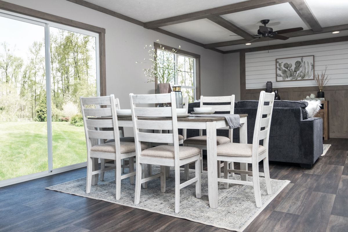 The ISABELLA Dining Area. This Manufactured Mobile Home features 3 bedrooms and 2 baths.