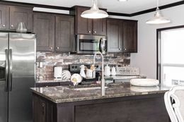The THE FRANKLIN XL Kitchen. This Manufactured Mobile Home features 4 bedrooms and 2 baths.