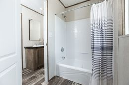 The THE NEW BREEZE II Guest Bathroom. This Manufactured Mobile Home features 4 bedrooms and 2 baths.