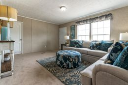 The THE EAGLE 60 Living Room. This Manufactured Mobile Home features 3 bedrooms and 2 baths.