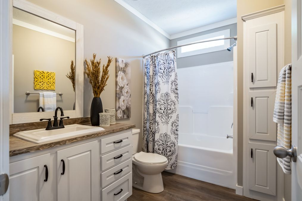 "The 1434 CAROLINA ""SOUTHERN BELLE"" Guest Bathroom. This Manufactured Mobile Home features 3 bedrooms and 2 baths."