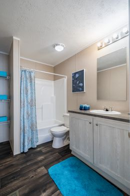 The ULTRA PRO 76 Guest Bathroom. This Manufactured Mobile Home features 4 bedrooms and 2 baths.
