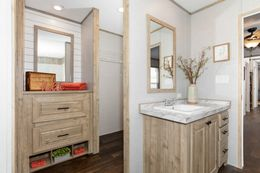The THE 1959 Master Bathroom. This Manufactured Mobile Home features 3 bedrooms and 2 baths.