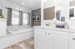 The THE CASCADE Master Bathroom. This Manufactured Mobile Home features 4 bedrooms and 2 baths.