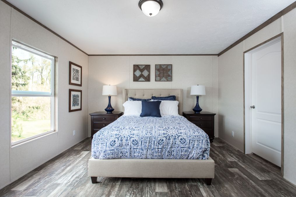 The THE NEW BREEZE II Master Bedroom. This Manufactured Mobile Home features 4 bedrooms and 2 baths.