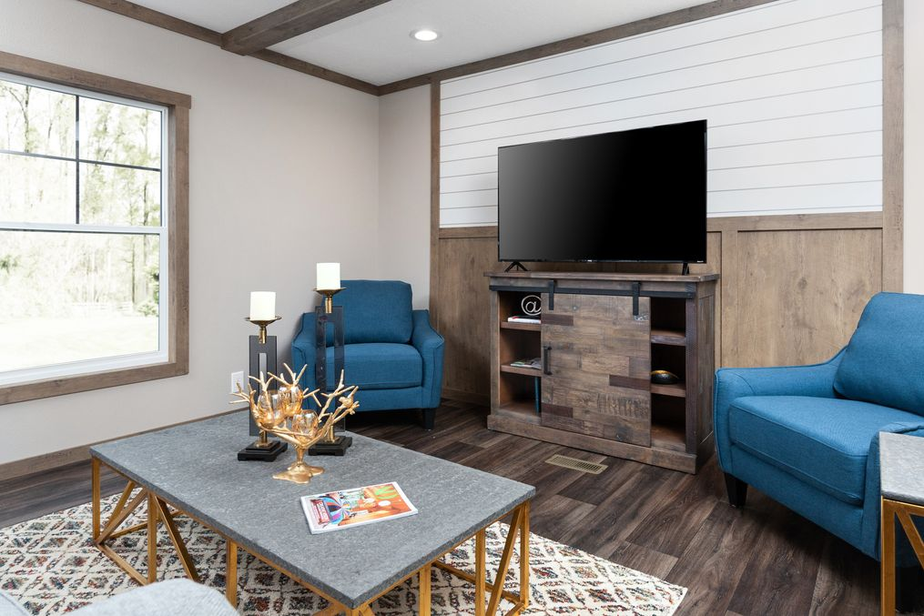 The ISABELLA Living Room. This Manufactured Mobile Home features 3 bedrooms and 2 baths.