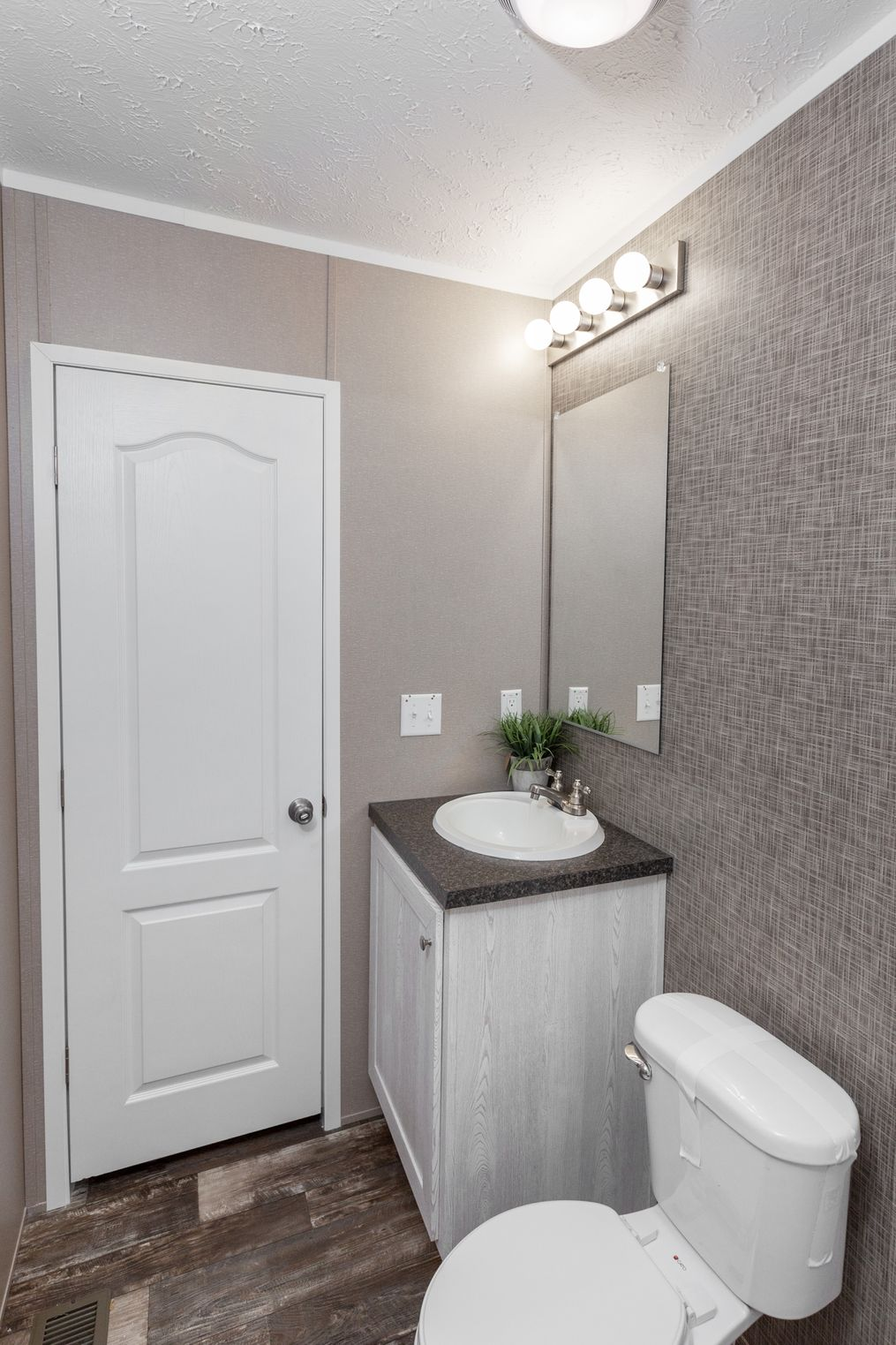The THE ANNIVERSARY PLUS Master Bathroom. This Manufactured Mobile Home features 3 bedrooms and 2 baths.