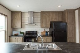 The THE NEW BREEZE II Kitchen. This Manufactured Mobile Home features 4 bedrooms and 2 baths.