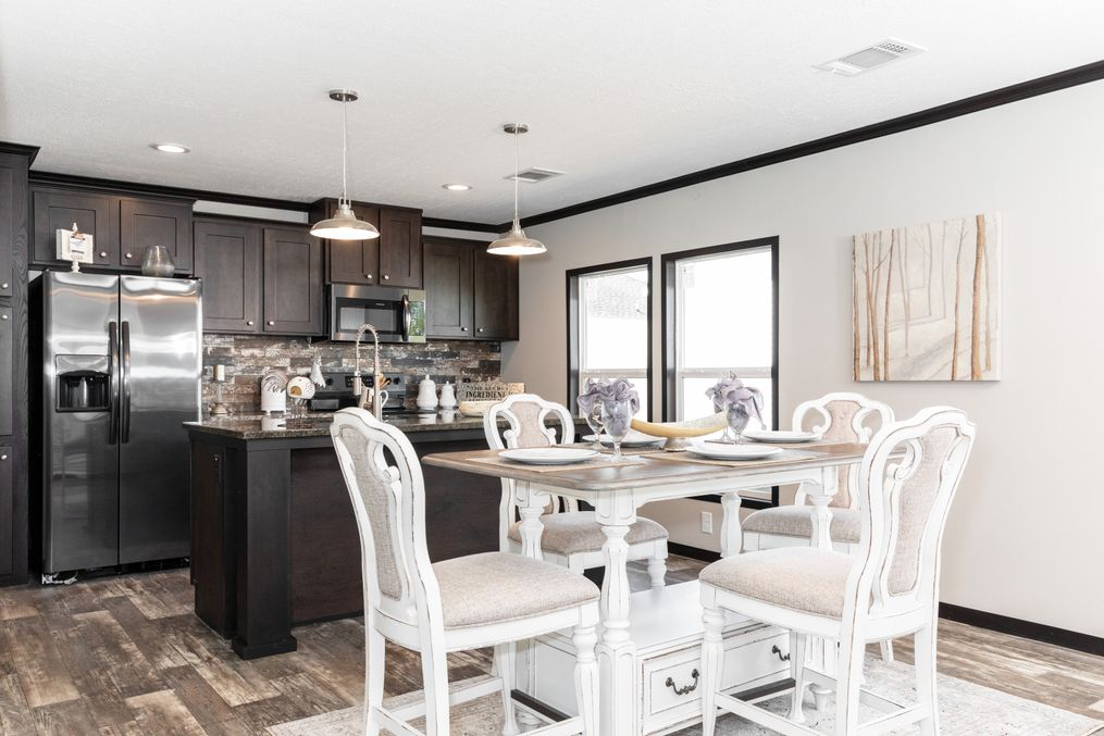 The THE FRANKLIN XL Dining Area. This Manufactured Mobile Home features 4 bedrooms and 2 baths.