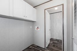 The THE SOCIAL 76 Utility Room. This Manufactured Mobile Home features 3 bedrooms and 2 baths.