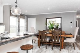The THE CASCADE Dining Area. This Manufactured Mobile Home features 4 bedrooms and 2 baths.