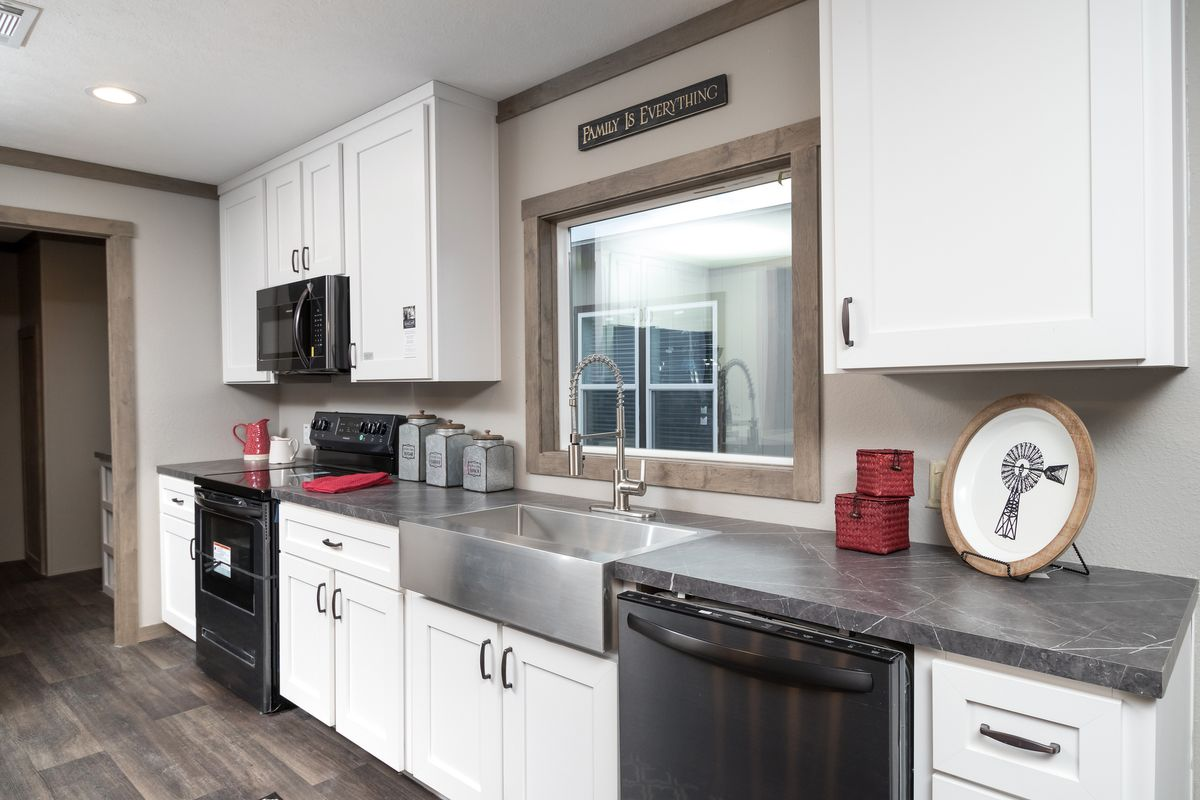 The FARMHOUSE 4 Kitchen. This Manufactured Mobile Home features 4 bedrooms and 2 baths.