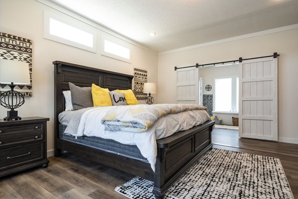 "The 1434 CAROLINA ""SOUTHERN BELLE"" Master Bedroom. This Manufactured Mobile Home features 3 bedrooms and 2 baths."