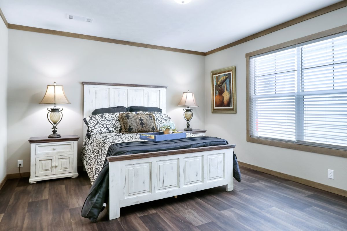 The AMELIA Master Bedroom. This Manufactured Mobile Home features 4 bedrooms and 2 baths.