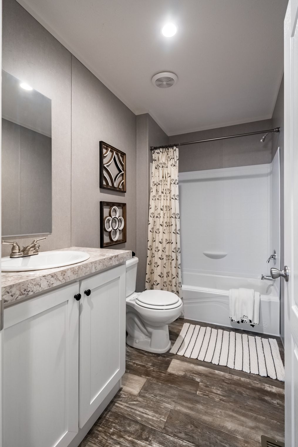 The TRADITION 48 Guest Bathroom. This Manufactured Mobile Home features 3 bedrooms and 2 baths.