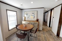 The BREEZE FARMHOUSE 72 Dining Area. This Manufactured Mobile Home features 4 bedrooms and 2 baths.