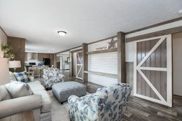 The THE NEW BREEZE II Living Room. This Manufactured Mobile Home features 4 bedrooms and 2 baths.