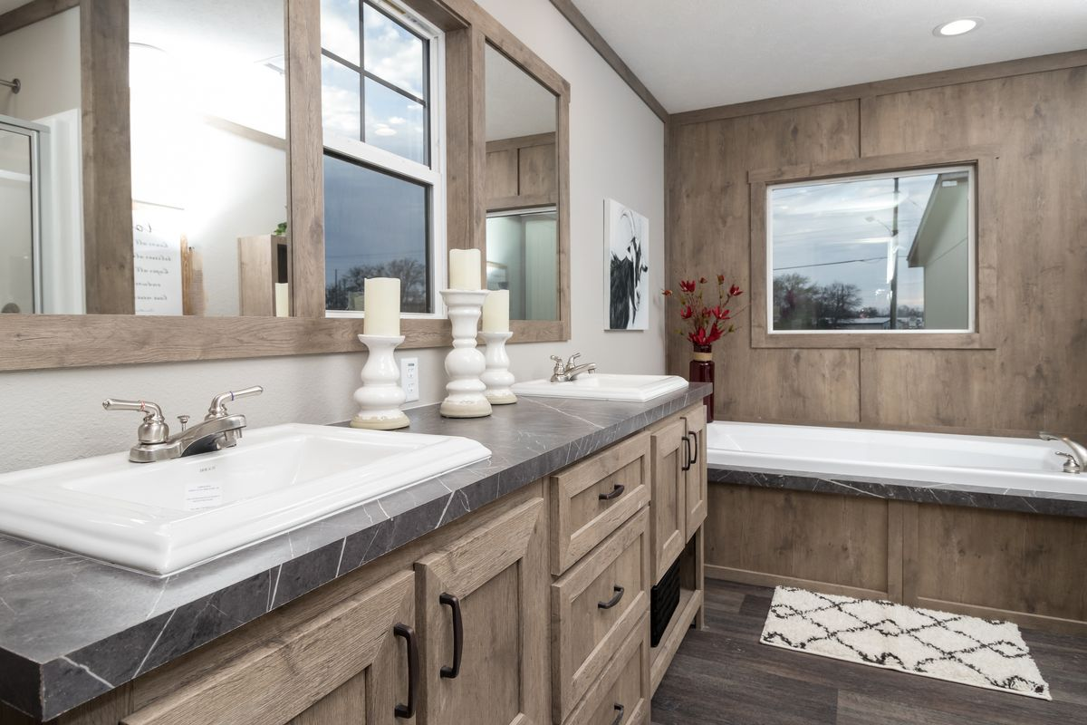 The FARMHOUSE 4 Master Bathroom. This Manufactured Mobile Home features 4 bedrooms and 2 baths.