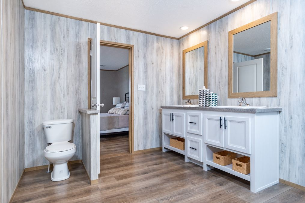 The EVEREST Master Bathroom. This Manufactured Mobile Home features 4 bedrooms and 2 baths.