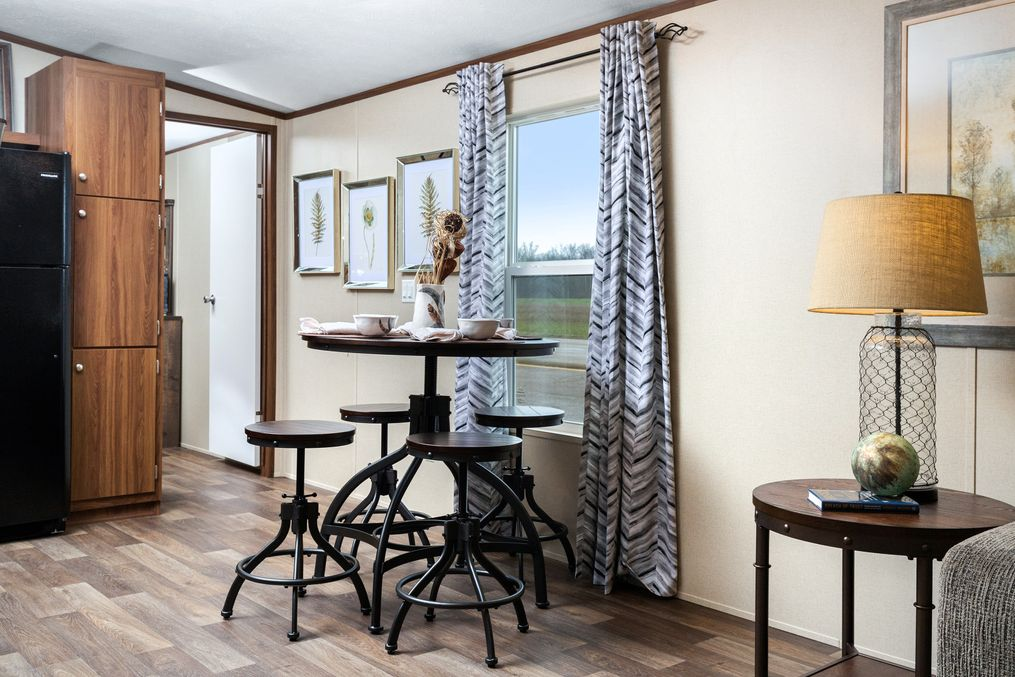 The VICTORY PLUS Dining Area. This Manufactured Mobile Home features 3 bedrooms and 2 baths.