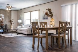 The ULTRA PRO BIG BOY Dining Area. This Manufactured Mobile Home features 4 bedrooms and 2 baths.