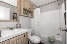 The THE 1959 Guest Bathroom. This Manufactured Mobile Home features 3 bedrooms and 2 baths.