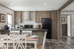The THE NEW BREEZE II Dining Area. This Manufactured Mobile Home features 4 bedrooms and 2 baths.