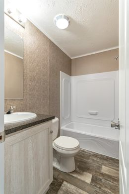 The THE ANNIVERSARY PLUS Guest Bathroom. This Manufactured Mobile Home features 3 bedrooms and 2 baths.