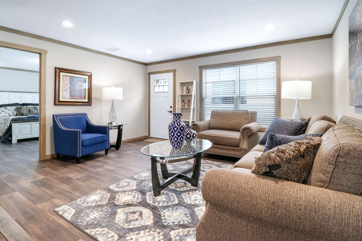 The AMELIA Living Room. This Manufactured Mobile Home features 4 bedrooms and 2 baths.