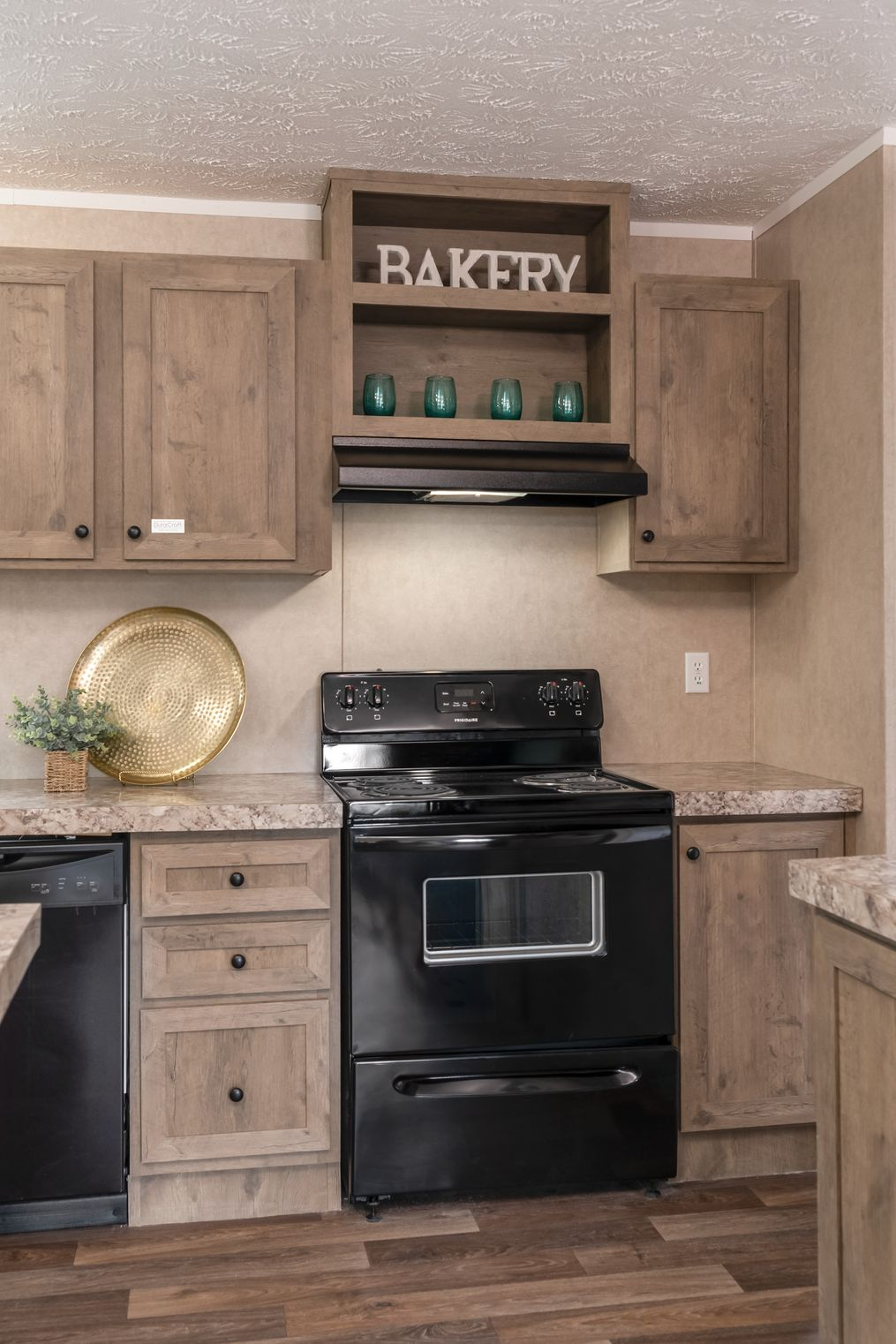 The THE EAGLE 60 Kitchen. This Manufactured Mobile Home features 3 bedrooms and 2 baths.