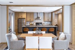 The EVEREST Dining Area. This Manufactured Mobile Home features 4 bedrooms and 2 baths.