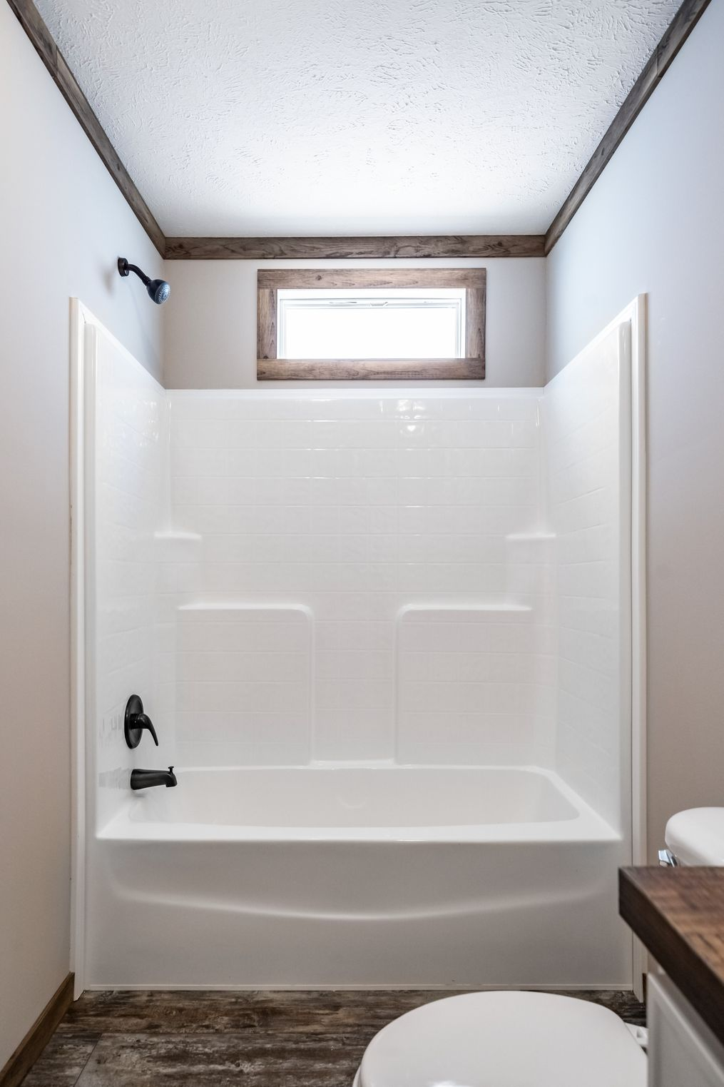 The THE BOBBY JO Guest Bathroom. This Manufactured Mobile Home features 3 bedrooms and 2 baths.