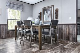 The SIG28663A Dining Area. This Manufactured Mobile Home features 3 bedrooms and 2 baths.