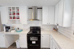 The BREEZE FARMHOUSE 72 Kitchen. This Manufactured Mobile Home features 4 bedrooms and 2 baths.