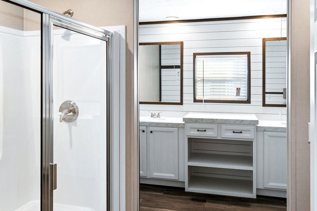 The BREEZE FARMHOUSE Master Bathroom. This Manufactured Mobile Home features 3 bedrooms and 2 baths.
