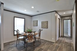 The BREEZE FARMHOUSE Dining Area. This Manufactured Mobile Home features 3 bedrooms and 2 baths.