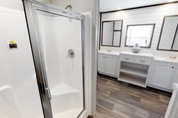 The BREEZE FARMHOUSE 72 Master Bathroom. This Manufactured Mobile Home features 4 bedrooms and 2 baths.