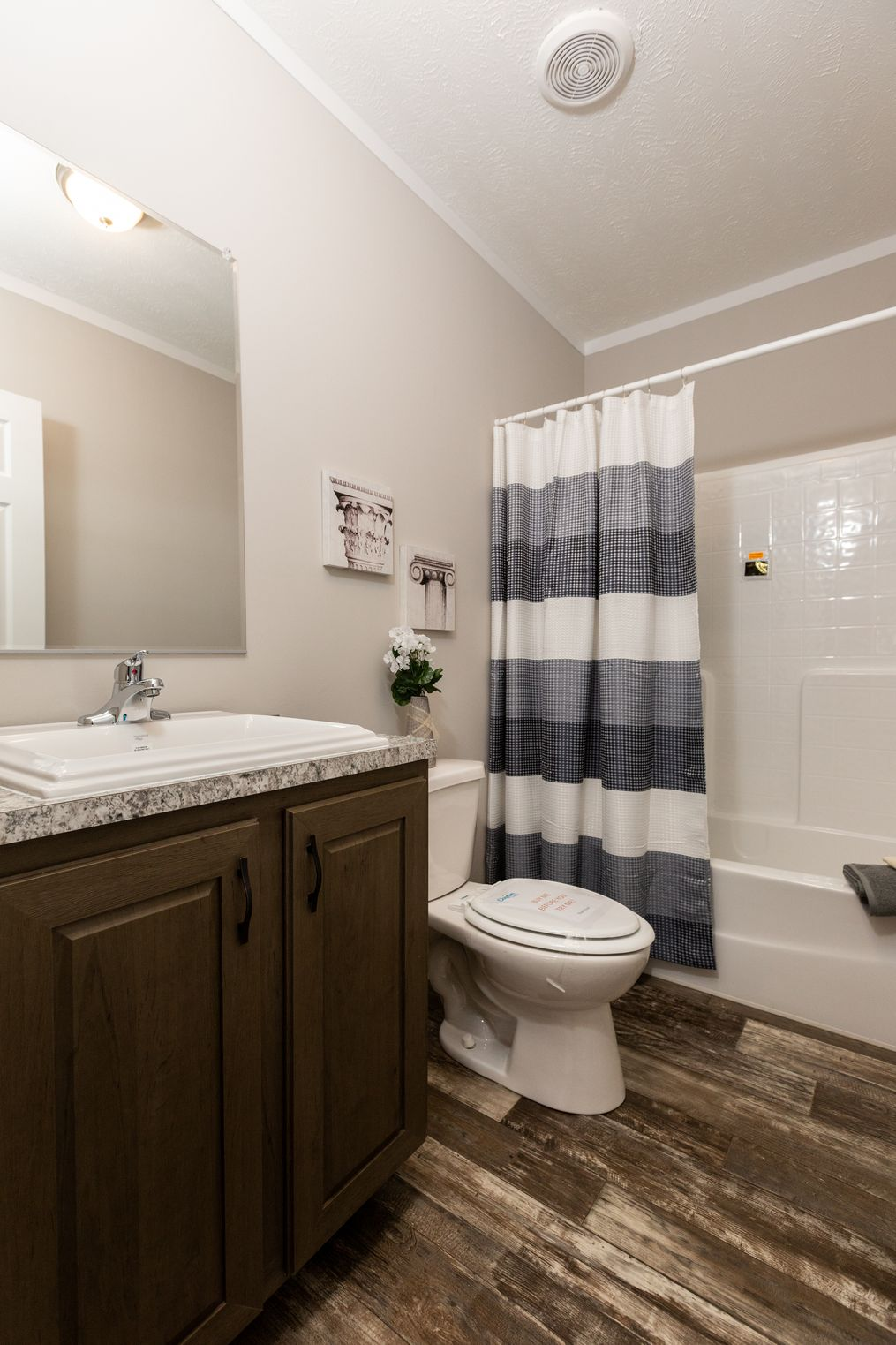 The CLASSIC 56D Guest Bathroom. This Manufactured Mobile Home features 3 bedrooms and 2 baths.