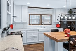The BREEZE FARMHOUSE Kitchen. This Manufactured Mobile Home features 3 bedrooms and 2 baths.