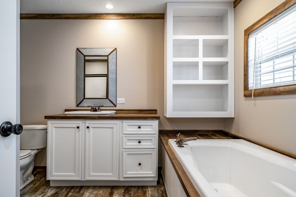 The THE BOBBY JO Master Bathroom. This Manufactured Mobile Home features 3 bedrooms and 2 baths.