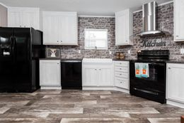 The THE ANNIVERSARY PLUS Kitchen. This Manufactured Mobile Home features 3 bedrooms and 2 baths.