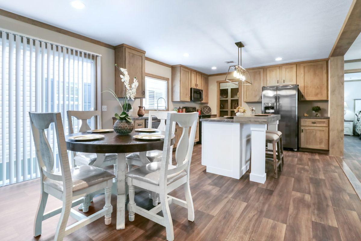 The AMELIA Dining Area. This Manufactured Mobile Home features 4 bedrooms and 2 baths.