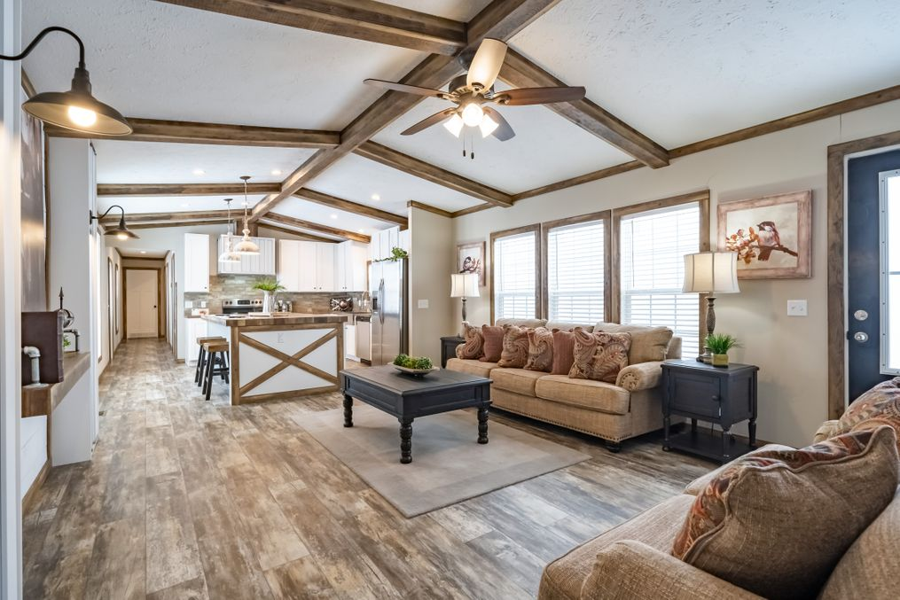 The THE BOBBY JO Living Room. This Manufactured Mobile Home features 3 bedrooms and 2 baths.
