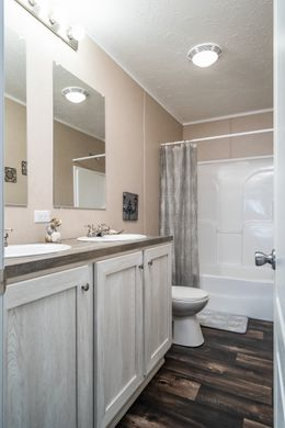 The ULTRA PRO BIG BOY Guest Bathroom. This Manufactured Mobile Home features 4 bedrooms and 2 baths.